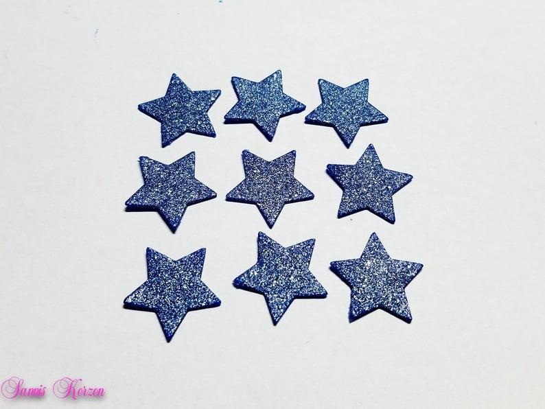 Wachs-Sterne dunkelblau-silber Glitter für nur  1,65€
