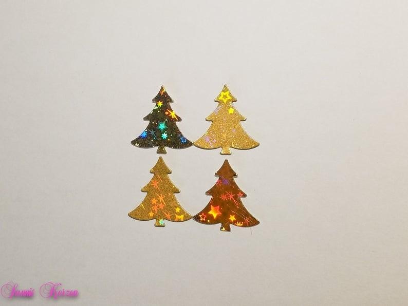 4 Wachs-Bäume mit Glitzer Sternen gold für nur 3,00€