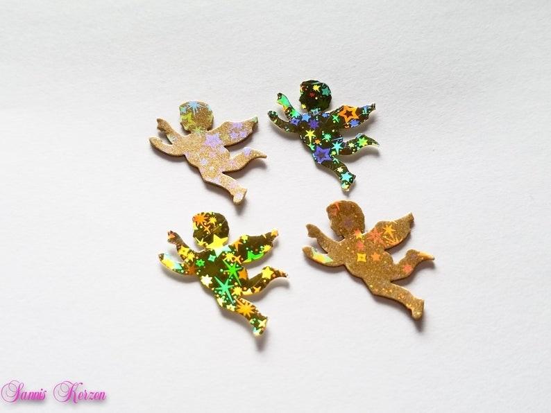 4 Wachs-Engel mit Glitzer Sternen gold für nur 2,40€